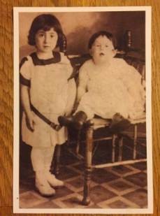 A photograph of the author's Aunt Ruth Scher as a baby (sitting on the chair), next to her Aunt Signa Scher.