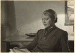 Edith_Halpert_reading_at_the_home_of_Charles_Sheeler,_between_1933_and_1942