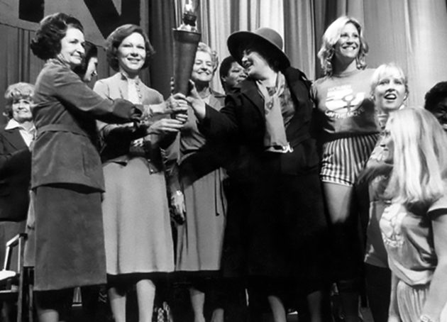Bella Abzug passes the Olympic Torch to First Ladies at the National Women's Conference, Houston, Texas
